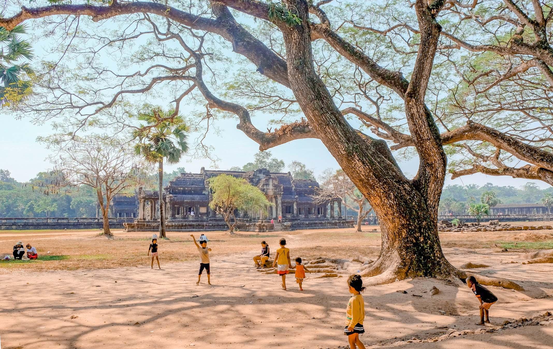 local kids playing at angkor wat