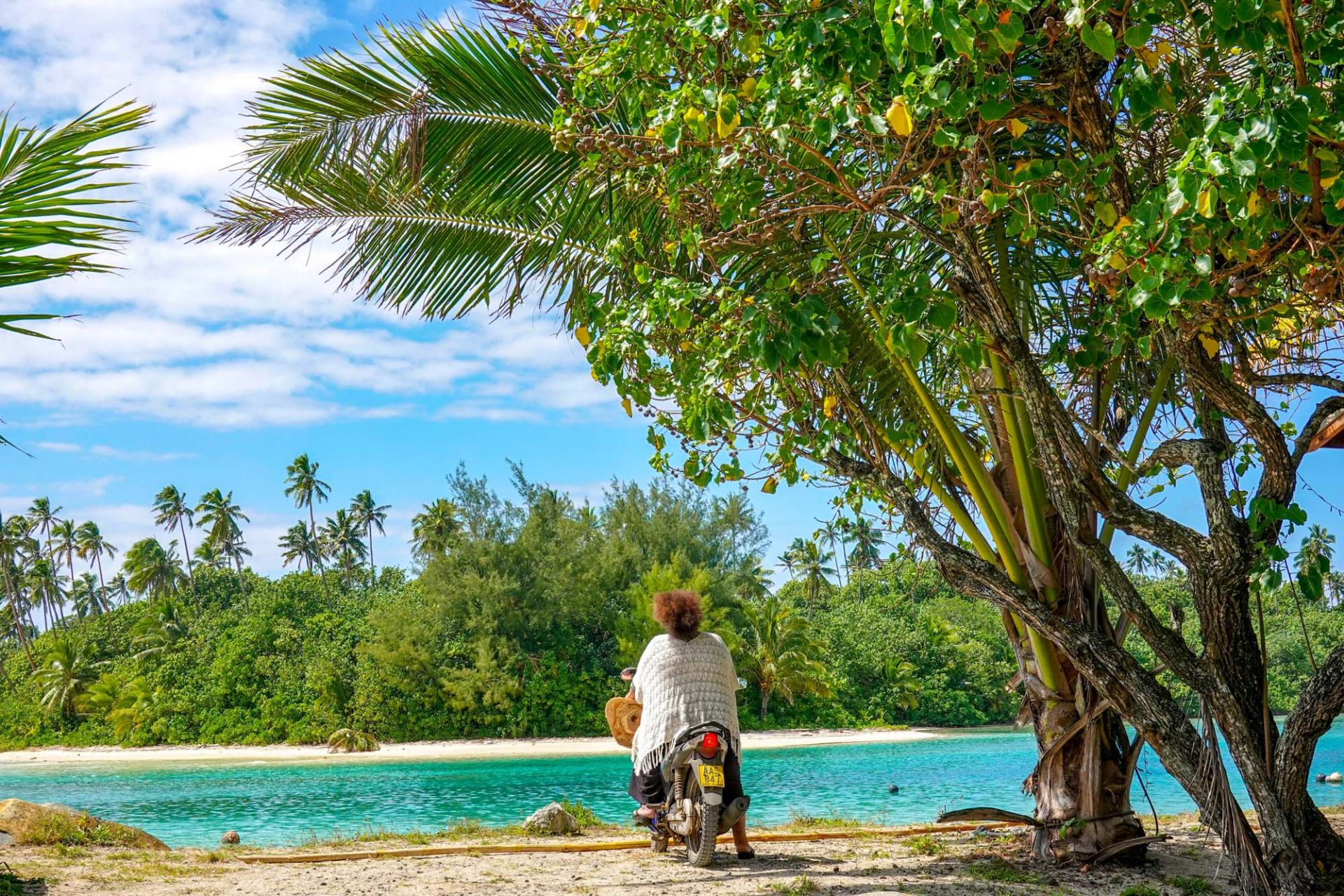 lady on motorbike exploring the cook islands